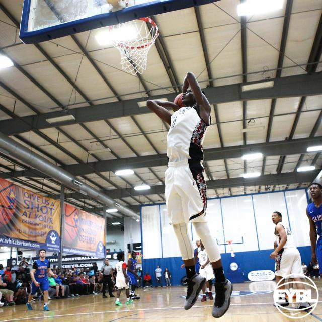 "#1 overall 2016 6' 10"" PF Harry Giles goes up for the slam on the break. -Jon Lopez, Nike"
