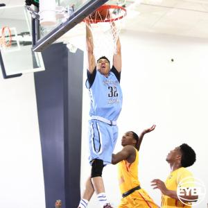 "Howard Pulley 2016 6' 6"" SF Jamil Jackson goes up for the slam between defenders. -Jon Lopez, Nike"