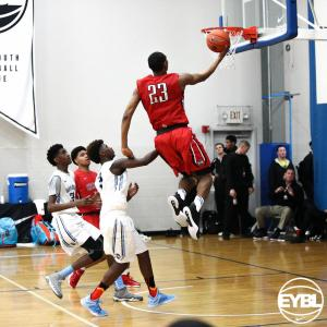 "Expressions Elite 2017 6' 6"" SF Jermaine Samuels Jr goes up for the layup over his defender. -Jon Lopez, Nike"