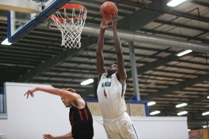 Nike South Beach 2017 7-footer Zach Brown goes up for the dunk over the defender. -Jon Lopez, Nike