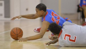 Star 2017 SF DJ Harvey dives after the lose ball for Dematha Catholic (MD).
