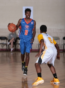 2017 PG Jalek Felton brings the ball up the court in the 2014 UA Association Finals. -Kelly Kline, Under Armour