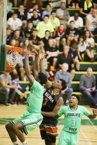 Star 2016 SF Josh Jackson throws down the dunk on the defender for Prolific Prep (CA).