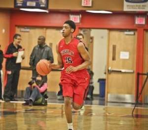 Justin Jackson brings the ball up for his high school team Findlay Prep (NV).