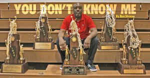 Simeon HS (IL) head coach Robert Smith poses with his 5 Illinois State Titles.