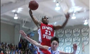 Seventh Woods skies for the dunk over his defender.