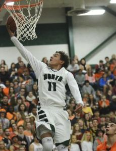 2017 Trae Young goes up for the layup for his high school team Norman North (OK).